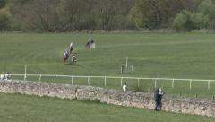 Racehorses round a bend. Stock Footage