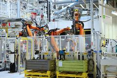Automatic robot in car factory Stock Photos