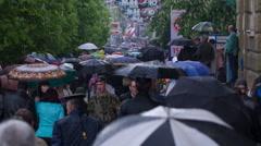 People with Umbrellas Walk Under the Rain 6 - stock footage