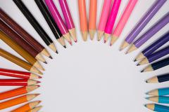 Smiling sun arranged from crayons and pencil sharpenings. - stock photo