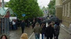 People with Umbrellas Walk Under the Rain 5 - stock footage