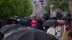 People with Umbrellas Walk Under the Rain 4 - stock footage