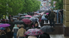 People with Umbrellas Walk Under the Rain 3 Stock Footage