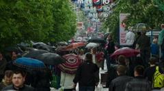 People with Umbrellas Walk Under the Rain 2 - stock footage