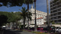Cannes, Carlton Hotel and traffic on boulevard de la croisette, France - stock footage