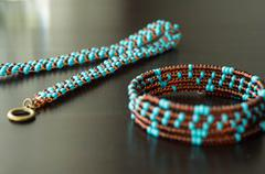 Wattled necklace and bracelet from beads - stock photo
