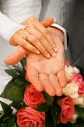 Hands of newly-married - stock photo