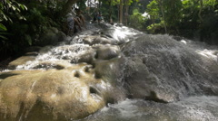 Water flowing over the rocks at Dunn's River Falls, Jamaica Stock Footage