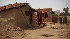 Laundry drying in poor drought village house, India, medium shot, shallow DOF Stock Footage
