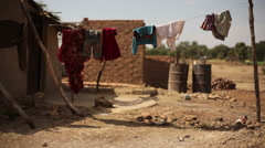 Laundry drying in poor drought village house, India, close up, shallow DOF Stock Footage