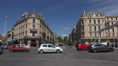 Traffic passes Boulevard Carnot at place du 18 Juin, Cannes, France Stock Footage