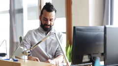 Happy creative male office worker with computer Stock Footage