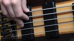 Playing 5 String Electric Bass Guitar - stock footage