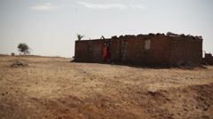 Poor village house in drought dry area, India, long shot Stock Footage