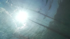 Underwater fishnet beautifully illuminated by sunlight in slow motion Stock Footage