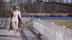Beautiful Girl in Sunglasses is Walking - stock footage