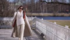 Beautiful Girl in Sunglasses is Walking - stock footage