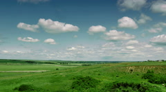 Panoramic view of green field Stock Footage