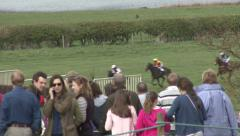 Spectators watch a horse race. Stock Footage