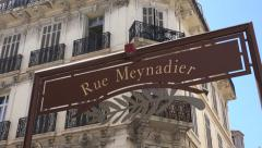 Zoom out, Rue Meynadier sign in Old Town Cannes, France Stock Footage