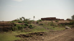 House in drought village in India, long shot, shallow DOF Stock Footage