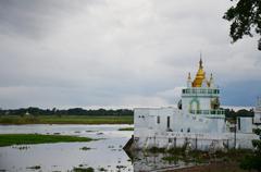 Church temple beside U Bein  Wooden longest Bridge in Amarapura, Myanmar. Stock Photos
