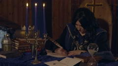 Young Queen writing a letter Stock Footage