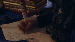 Young Queen writing a letter - stock footage