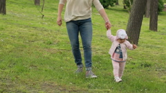 Little Girl Walking With Her Mother Stock Footage