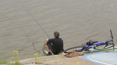 Man Fishes on The River Bank Stock Footage