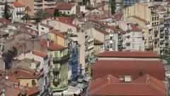 Zoom out from rooftop buildings of Cannes, France Stock Footage