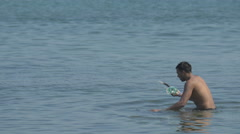 Man walking in the sea in Jamaica Stock Footage