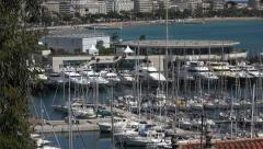 Zoom out from yachts in Cannes harbour on sunny day, France Stock Footage
