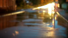 traffic in rain, headlights reflected in the puddles - stock footage