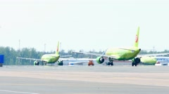 Two S7 Airbus 320 taxiing on the apron after landing Stock Footage