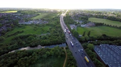 Aerial view of traffic driving along a road at sunset 4K Stock Footage