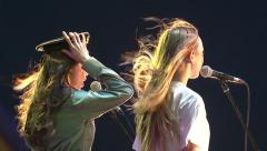 Two girls sing a song on the stage. Stock Footage