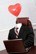 Suit with balloon - stock photo