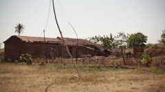 Village red mud house, India, long shot, shallow DOF Stock Footage