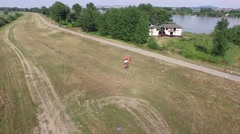 Aerial view of traktor park on field Stock Footage