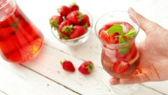 Fresh strawberry with cooling homemade lemonade on the wooden table Stock Footage
