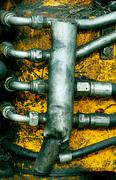 Dirty oily Hydraulic pressure pipes system - stock photo