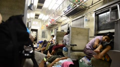 Burmese people and foreigner traveler sitting and sleeping on train Stock Footage