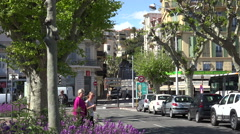Street scene along waterfront at Cannes, France Stock Footage