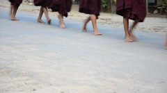 Feet of Monk procession walking on the road for people pray and put food offerin Stock Footage