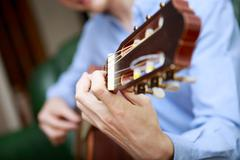 Young musician playing at acoustic guitar Stock Photos