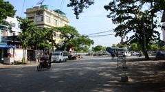 Burmese people and traffic on the road at 79 street in Mandalay, Myanmar Stock Footage