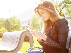 Young woman typing sms message Stock Photos