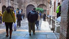 4k tourist pov at entrance to house of Juliet in Verona, Italy Stock Footage
