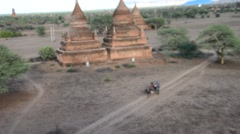 Horse drawn carriage for traveller tour around Bagan Archaeological Zone Stock Footage